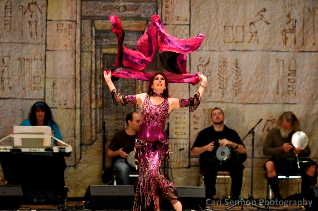 Dhyanis, Marin belly dancer, performs in fuschia to live music.