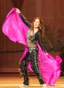 Belly dancer, Dhyanis, performs on stage in Marin.