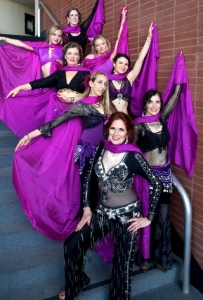 San Rafael-based bellydancers, Troupe Dhyanis, pose with fuschia veils.