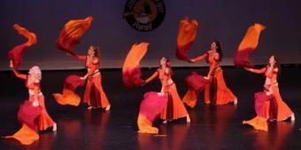 Belly dance troupe costumes in firey orange and maroon